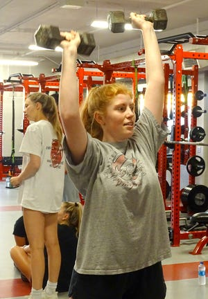 Ottawa High School senior Molly McGrath works to become stronger and quicker through the summer lifting sessions, which just finished its second week.