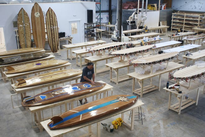 Little Bay Boards owner Jason Thelen works on some paddle boards in his new workshop in the old Kilwins factory at 355 Division Road in Petoskey.