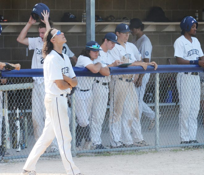 Kaden Rice (front) and other Petoskey players react to the final seconds after the final out of the season was called for them against Escanaba at home on Wednesday in a Division 2 regional semifinal.