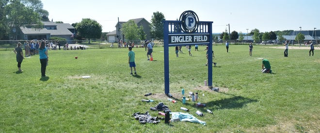 Students play kickball on the newly dedicated Engler Field at Sheridan Elementary School in Petoskey, named in honor of former longtime custodian Jeff Engler.