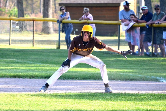 Pellston's Chase Zink leads off from first base during the top of the seventh inning against Rudyard on Wednesday.