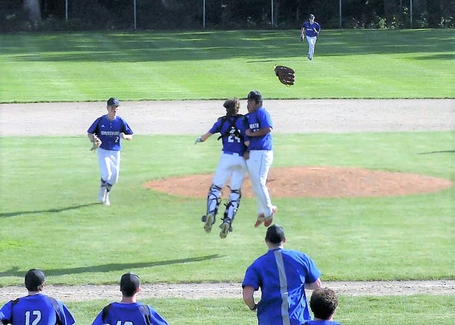 Somersworth pitcher Tahj Robinson and catcher Jeremy Levesque celebrate after Robinson struck out the final batter in Wednesday's 5-2 win over White Mountains in a Division III semifinal.
