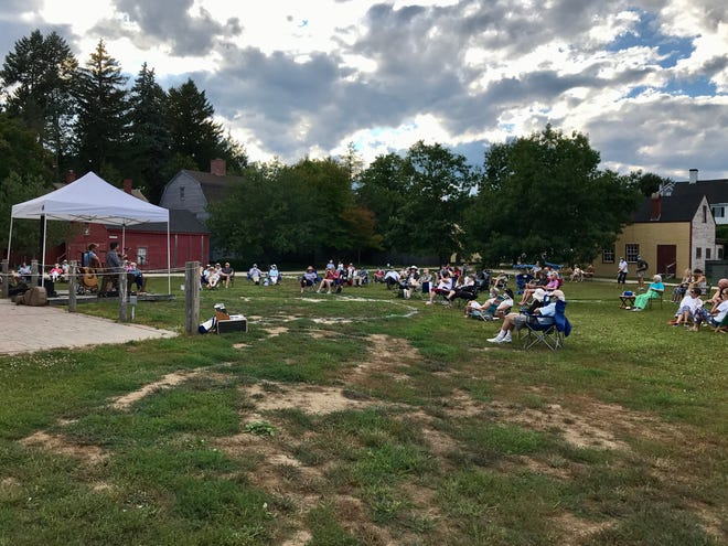 Visitors enjoy music by Jordan Tirrell-Wysocki from a Tuesdays on the Terrace concert in 2020 with COVID-19 precautions in place.