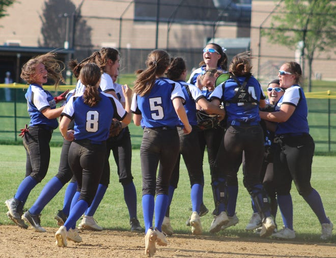 Members of the Oyster River softball team celebrate seconds following a 4-2 victory in the Division II semifinals over Merrimack Valley. The Bobcats play for the championship on Saturday against Milford at Rivier University in Nashua.