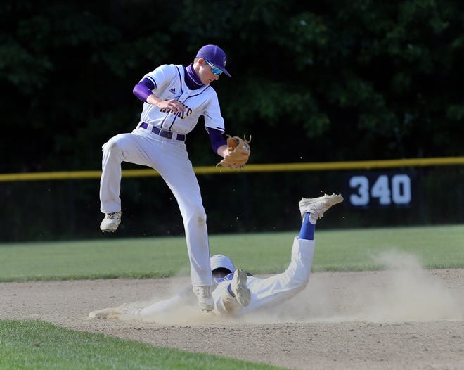 Marshwood shortstop Tim Gori tries to make a play on an attempted steal in Thursday's Class A South quarterfinal against Falmouth.