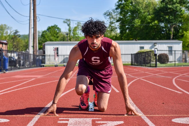 Stroudsburg senior Moeed Khan poses for a portrait photo at his school's track in Stroudsburg. Khan participated in track and field and football during his varsity athletics career.
