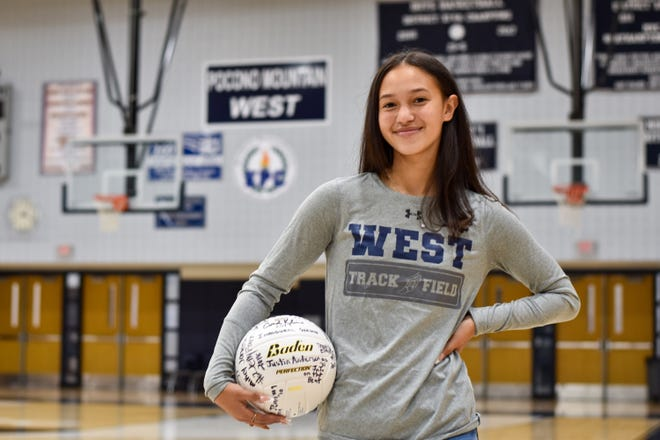 Pocono Mountain West senior Charli Cordoves poses with a volleyball inside West's gymnasium for a portrait photo in Pocono Summit. Cordoves, a three-sport athlete in high school, will attend Duke University in the fall.