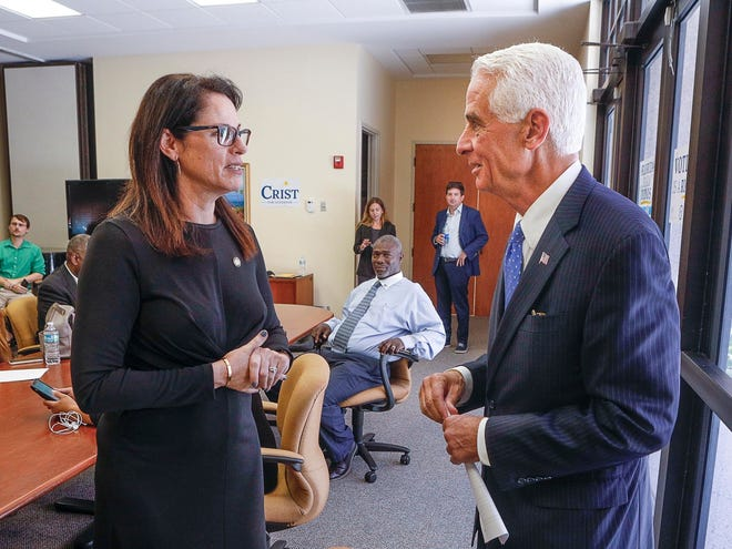 Gubernatorial candidate Charlie Crist chats with democratic member of the Florida senate, Tina Polsky, before participating in a roundtable discussion at the Service Employees International Union (SEIU) in West Palm Beach, Thursday, June 10, 2021.