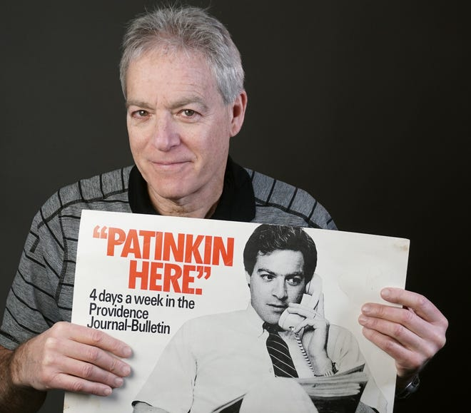 In this 2018 photo, columnist Mark Patinkin holds up a poster of himself from the early 1980s.