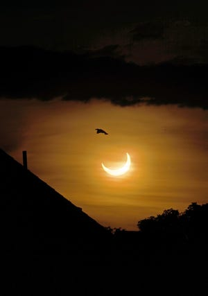 The partial eclipse left the sun looking like a crescent moon over Providence Thursday morning.
