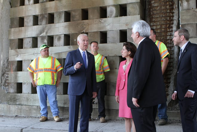 Then-Vice President Joe Biden talks about Rhode Island's infrastructure program with then-Gov. Gina Raimondo and state and local officials during a visit to East Providence in 2016.