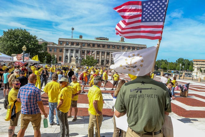With lawmakers considering a slate of gun-control measures this session, Second Amendment-rights advocates rally at the State House on June 10.