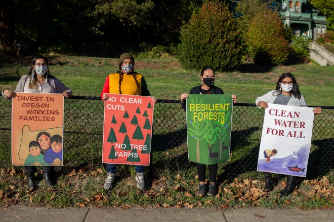 Members of Beyond Toxics, an environmental nonprofit organization, rally in Medford for farm worker protections in 2018. A resolution passed in the Oregon State Senate on Wednesday at the request of Beyond Toxics calls for the establishment of an environmental justice framework for state natural resource agencies' policies.