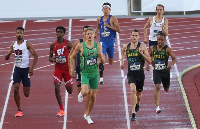 Charlie Hunter, center right, sprints for the finish to win his heat of the Men's 800 meters ahead of teammate Luis Peralta, right, during the semifinals at the NCAA Track and Field Championships at Hayward Field.