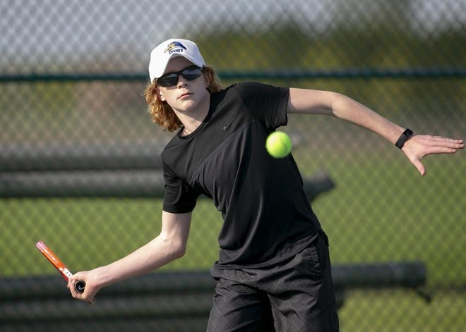 Rockford Christian's Finley Buelte, shown practicing at the school in 2019, moved into the quarterfinals of the state Class 1A boys tennis tournament on Thursday.