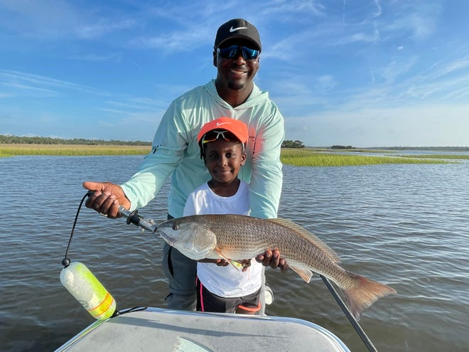 Marvin and Mckenzie Prior with a redfish caught up around Palm Valley with Captain Leon Dana on Thursday.