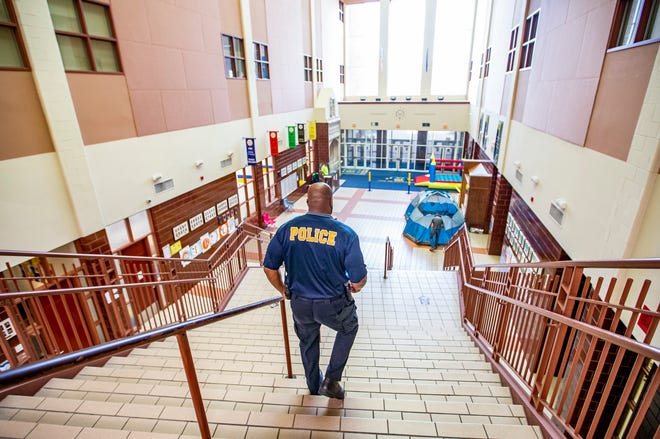Anthony Pearson, school resource officer at Riley High School, walks down the main staircase on Friday, May 21, 2021.