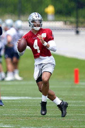 Dallas Cowboys quarterback Dak Prescott looks to pass during a team practice on Tuesday in Frisco.