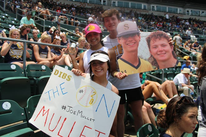 Yellow Jackets fans cheer on their favorite player during Wednesday's 4A State Semifinal game in Austin.