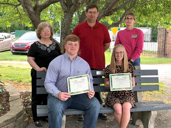 Gayle Baugh and Parker Hacker have each been awarded a scholarship from the Putnam County Master Gardener Associationfor the 2021-22 academic year.Baughwill be entering her sophomore year at Vincennes University. Her goal is to major in agriculture education through the VU/Purdue Cooperative Exchange Program.Hacker will be a freshman at Franklin College in the fall.He is pursuing a degree in ag business.Pictured are, front row, from left, Hacker and Baugh with, back row from left,Putnam County Master Gardener officers Jane Jackson, Jason Keeney and Kristi Nelson.