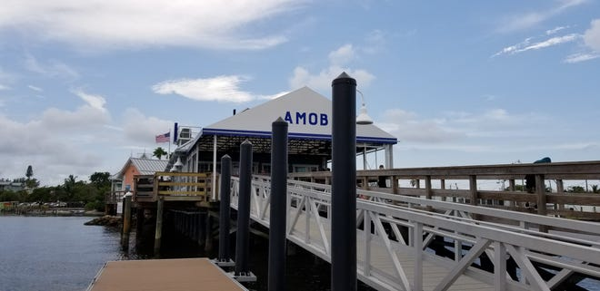 AnnaMariaOysterBar, which has multiple locations including this one on Anna Maria Island's historic Bridge Street Pier, is offering dad a complimentary beverage for Father's Day.