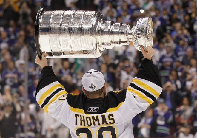 Boston Bruins goalie Tim Thomas hoists the Stanley Cup after the Boston Bruins beat the Vancouver Canucks 4-0 during Game 7 of the NHL hockey Stanley Cup Finals on June 15, 2011, in Vancouver, British Columbia.