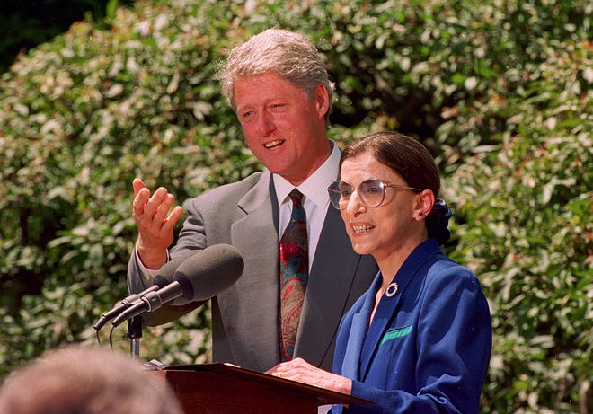 In this June 14, 1993, photo, President Bill Clinton poses with Ruth Bader Ginsburg, his nominee for the U.S. Supreme Court, during a news conference in Washington.