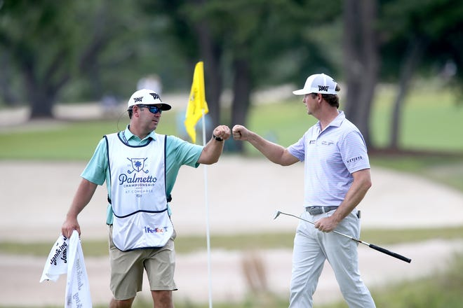 Hudson Swafford bumps fists with his caddie, Kyle Bradley, after sinking a 13-foot birdie putt on the ninth hole, his 18th, during the first round of the Palmetto Championship at Congaree on Thursday. The St. Simons Island resident finished with a 3-under-par 68.