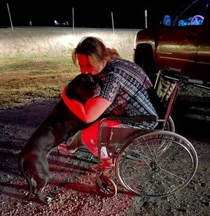 Pit bull mix Bella is reunited with her owner, Lilie Grabeel, on June 9, 2021 after being missing for nine days following a rollover crash on I-5.