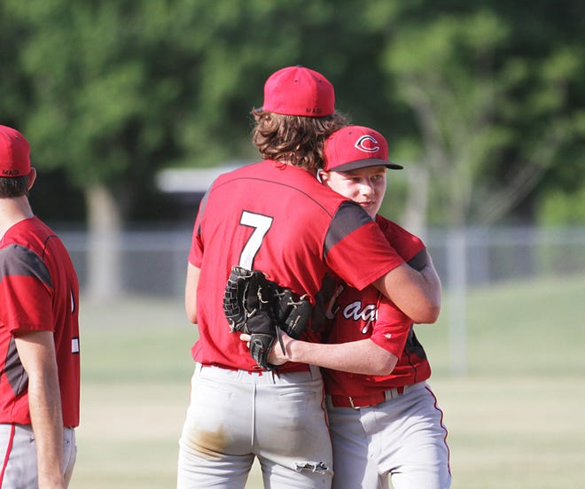 Colon's Josh West (7) and Kaleb Bissett share a hug after Bissett threw out the last Pittsford batter at first base on Wednesday.