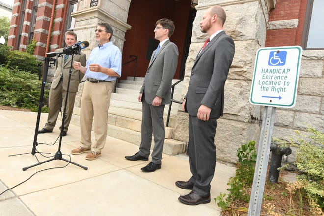 Retired Wilmington engineer Wayne Nutt speaks outside of the New Hanover County Courthouse Thursday to announce new federal lawsuit to protect his right to free speech.