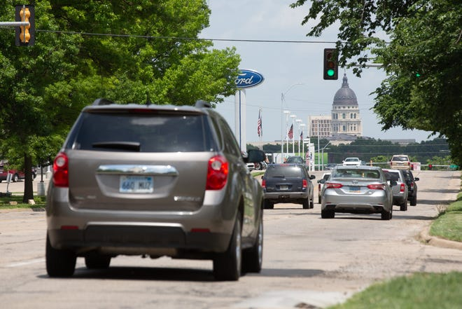 Traffic flows along S.W. Topeka Boulevard between 29th and 21st streets Thursday afternoon. U.S. Rep. Jake LaTurner, R-Kan., is requesting federal dollars to expedite resurfacing of the road.