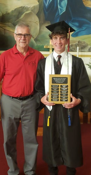 The Rev. Eric Shaulis is shown with Gabe Kretchman.