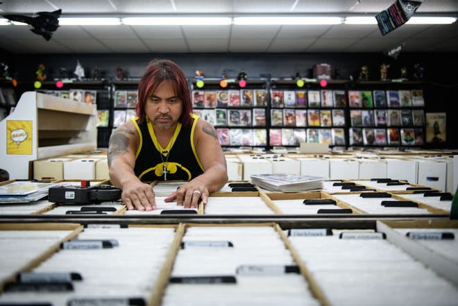 Owner Bernie Mangiboyat works on pricing comic books at The Dragon's Lair comic book store on Thursday, June 10, 2021.  The Dragon's Lair will be celebrating its 45th anniversary on Saturday, June 12.