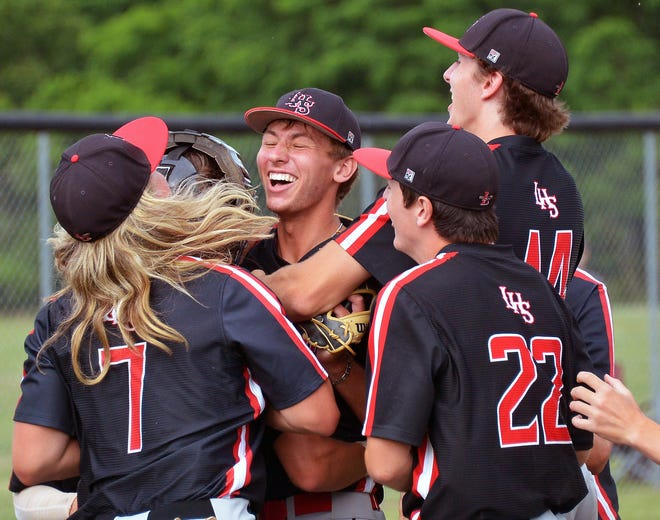 Linganore teammates swarm pitcher Matt Cunningham seconds after he completed pitching  a perfect game against North Hagerstown in the Maryland Class 3A West Region I semifinals. The Lancers won 7-0.