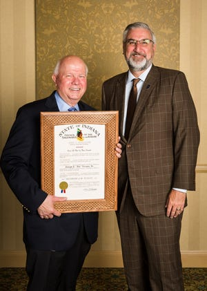 Joe Vezzoso, left French Lick Resort's Vice President of Sales, received the Sagamore of the Wabash award from Gov. Eric Holcomb at the Resort on June 8.