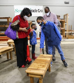Mason Bowden shows off the bench he built to his mother Daphne Bowden, father Morice, and brother Micah during a week at the Career Technical Summer Exploratory Camp at Northport CTE Annex at Tuscaloosa County High Thursday, June 10, 2021. [Staff Photo/Gary Cosby Jr.]