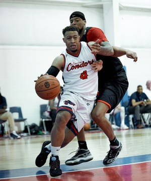 The Columbus Condors' Jaylen Benton drives to the basket during a recent TBL game against the Dayton Flight. Benton played for Northland and Westerville North and went on to play for Youngstown State.