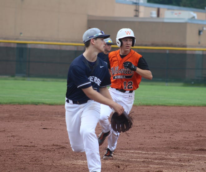 Cody Costello hustles to third base in Wednesday night's sectional win over Mynderse.