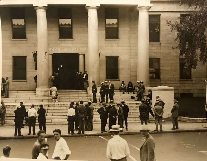 Reporters and others wait outside Norfolk Superior Court in Dedham during a plea for a new trial, Aug. 9, 1927.
