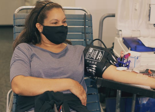 Alicia Scardigno gives blood at a New Jersey Blood Services pop-up.