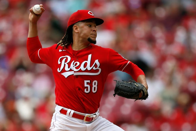 Cincinnati Reds starting pitcher Luis Castillo (58) throws a pitch in the fourth inning of the MLB National League game between the Cincinnati Reds and the Milwaukee Brewers at Great American Ball Park in downtown Cincinnati on Thursday, June 10, 2021. The game was tied 1-1 as a rain delay was called in the top of the fifth.