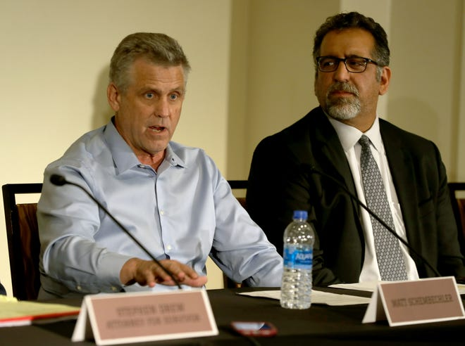 Matt Schembechler, left, and his attorney Mick Grewal talk with reporters about sexual assault allegations against Michigan doctor Robert E. Anderson on Thursday in Detroit.