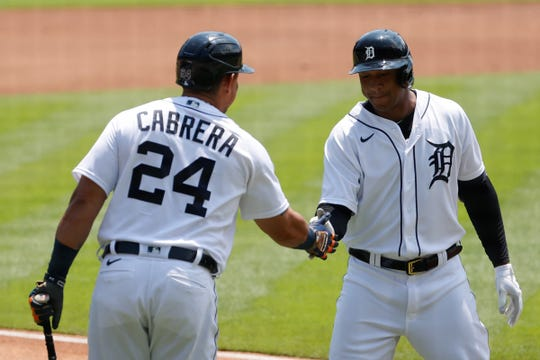 Detroit Tigers second baseman Jonathan Schoop (7) receives congratulations from designated hitter Miguel Cabrera (24) after hitting a home run in the first inning on June 10, 2021 against the Seattle Mariners at Comerica Park.
