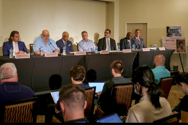 From left, Attorney Jonathan Marko, former Michigan football player Daniel Kwiatkowski, attorney Stephen Drew, Matt Schembechler, attorney Mick Grewal,  former Michigan football player Gilvanni Johnson and attorney Dennis Mulvihill talk with reporters Thursday, June 10, 2021 at the Sheraton Detroit Novi hotel about sexual assaults committed by former team doctor Robert E. Anderson. Schembechler, Kwiatkowski and Johnson said they each told then-coach Bo Schembechler about Anderson's abuse but the coach did nothing.