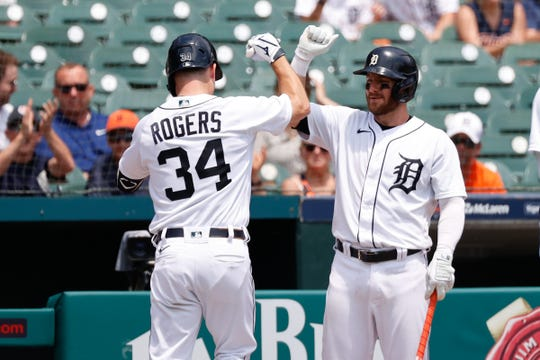 Detroit Tigers catcher Jake Rogers (34) receives congratulations from left fielder Robbie Grossman (8) after hitting a home run in the second half on June 10, 2021 against the Seattle Mariners at Comerica Park.