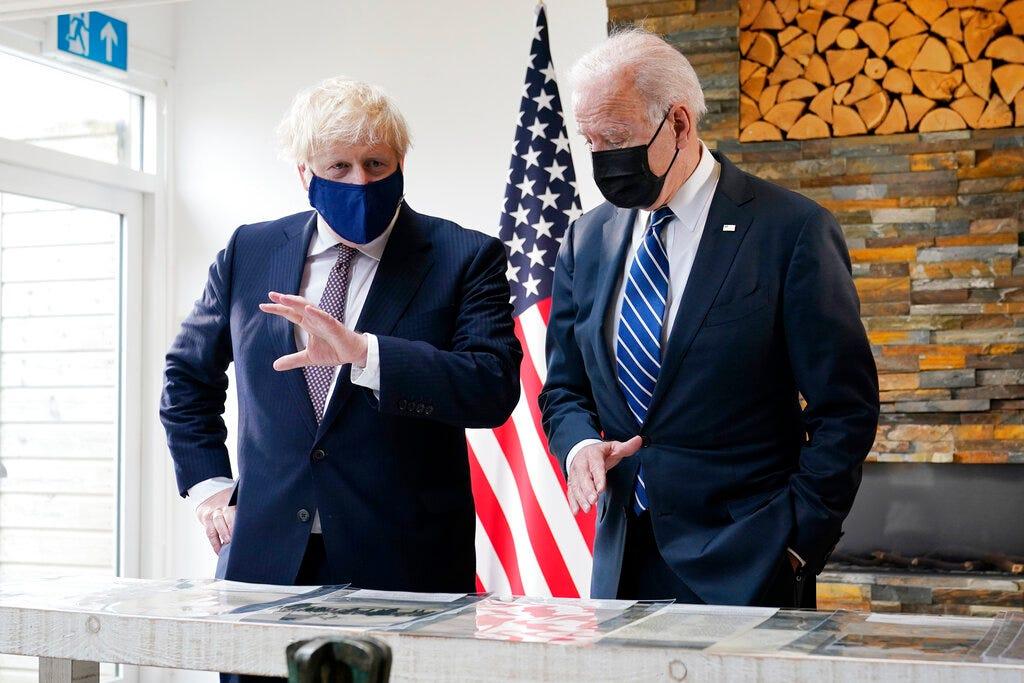 Biden, Johnson strike convivial tone in 1st meeting 2