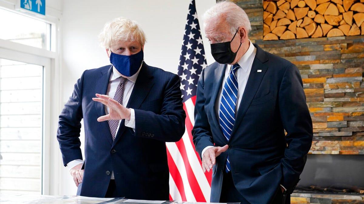 Biden, Johnson strike convivial tone in 1st meeting 3