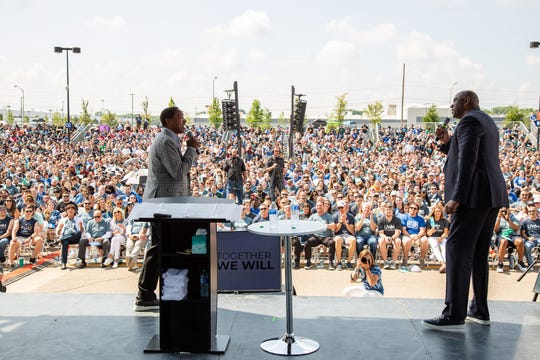 Basketball stars Magic Johnson and Isiah Thomas speak to United Wholesale Mortgage employees during a rally on Wednesday.