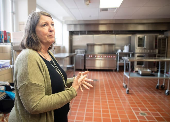Director Lisa Anderson leads a tour around the Room in the Inn in Memphis, Tenn., on Thursday June 9, 2021. The facility offers a Family Inn and recuperative care for people experiencing homelessness.